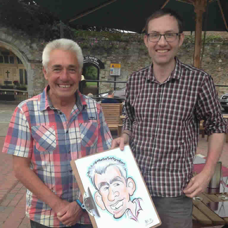 Will and a happy cutomer with a caricature from an event